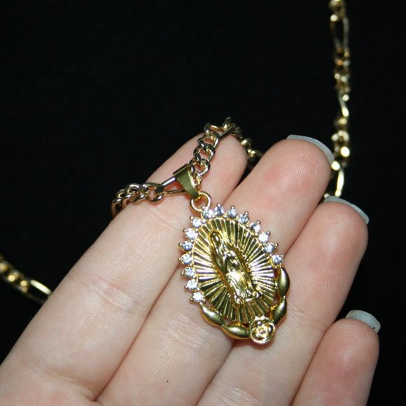 Beautiful gold chain necklace with Virgin Mary